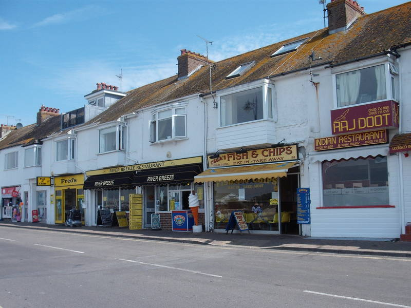 Littlehampton Shops Opposite The View Of  River Arun And Boats