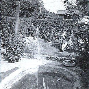 Surridge_Photo_Winifred_Surridge_by_pond_in_back_garden_109_Birchway_Hayes