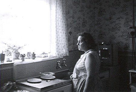 Surridge_Photo_Winifred_Surridge_in_kitchen_at_109_Birchway_Hayes