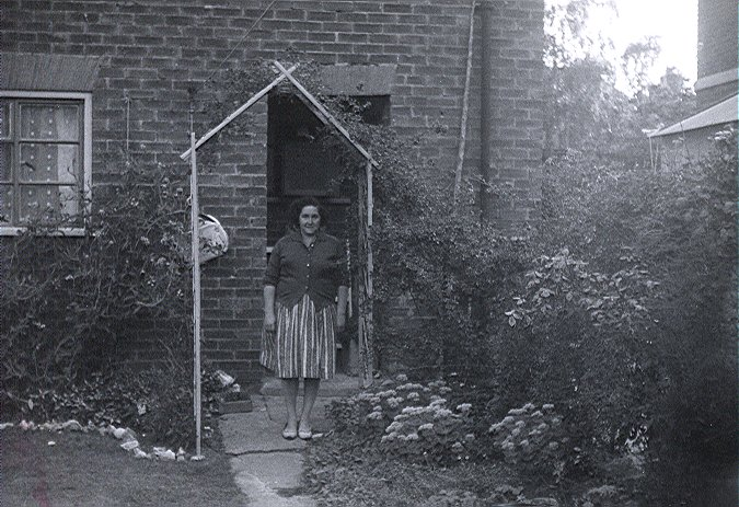 Surridge_Photo_Winifred_Surridge_outside_in_back_garden_109_Birchway_Hay