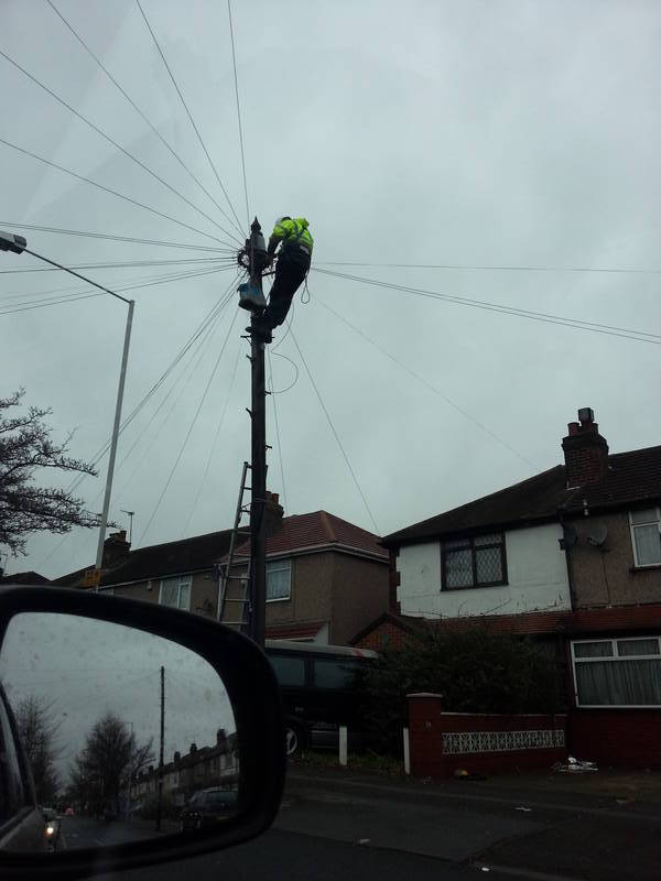 Telephone engineer up pole in Lansbury Drive